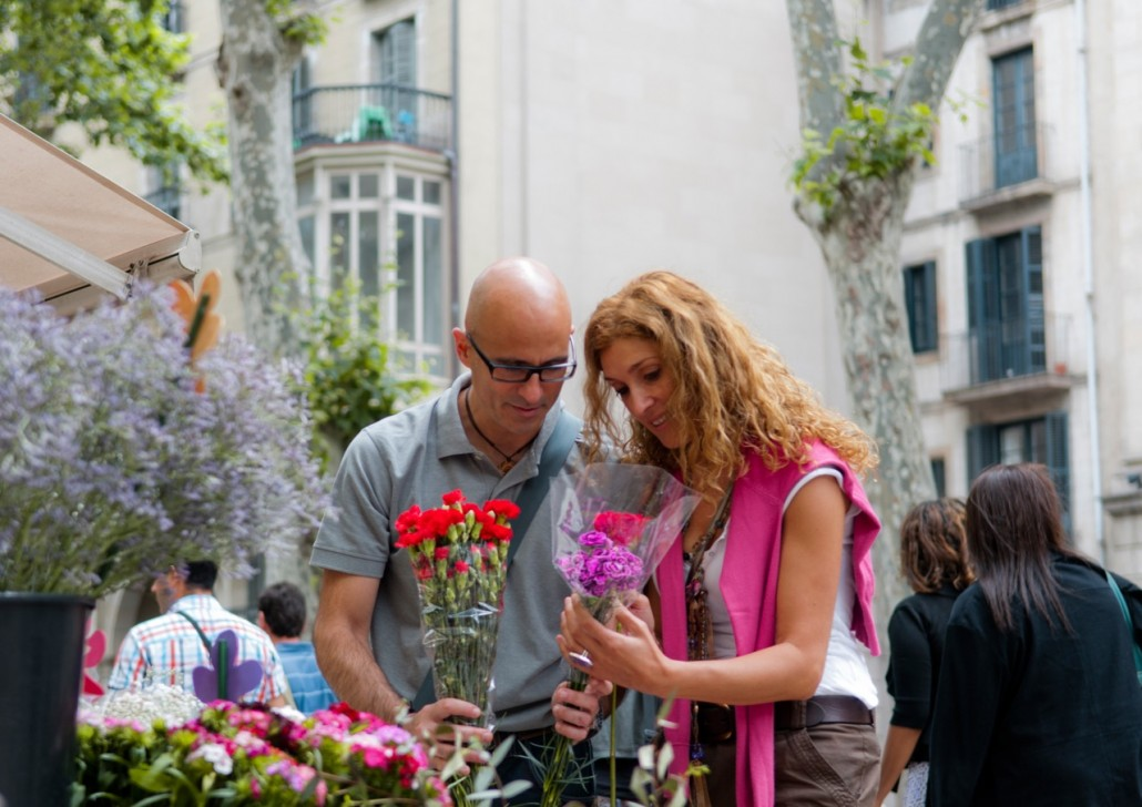 La Rambla, the city's most famous street and the main avenue of its old section.  It's crowded and lively, with lots of touristy shops. Carme and Tomi by a florist of the Rambla.