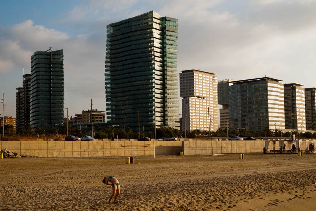 Beach of Barcelona, Spain. A woman doing fitness in the morning