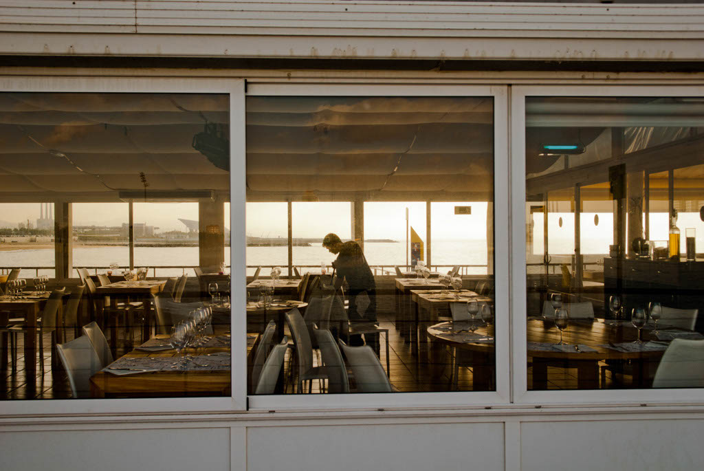 Beach of Barcelona, Spain. Cleaning the La Oca restaurant, one of the olders and most famous in the beach
