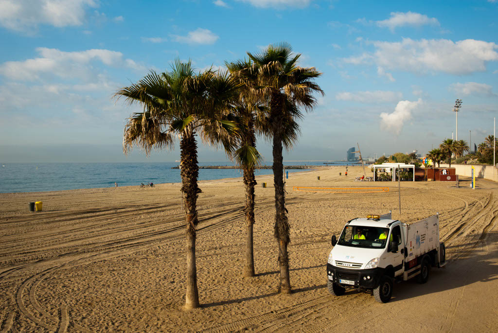 Beach of Barcelona, Spain. Cleeaning the beach in the morning