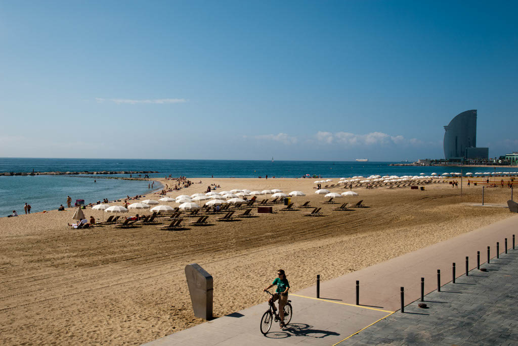Beach of Barcelona, Spain. General view with the Hotel W at the end of the beach