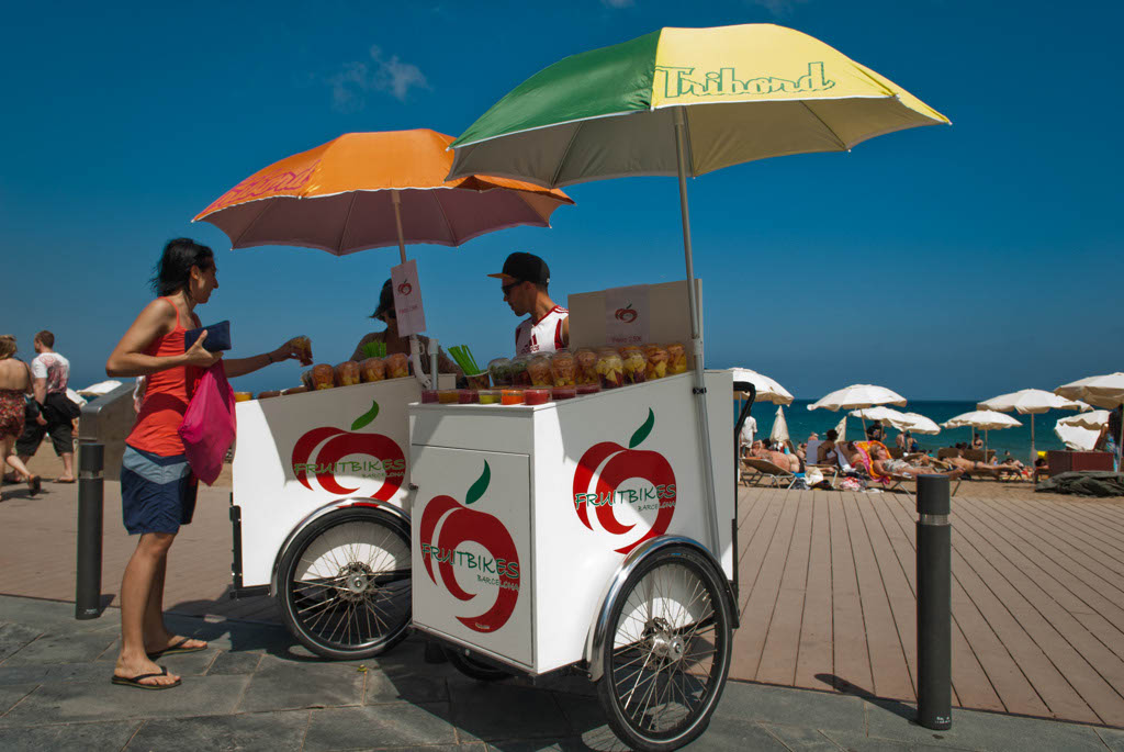 Beach of Barcelona, Spain. Fruit and Juices sellers on the promenade