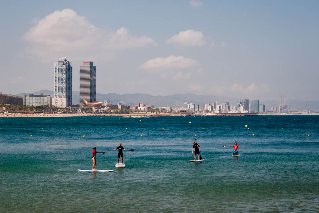 Beach of Barcelona, Spain. Surf training on the sea