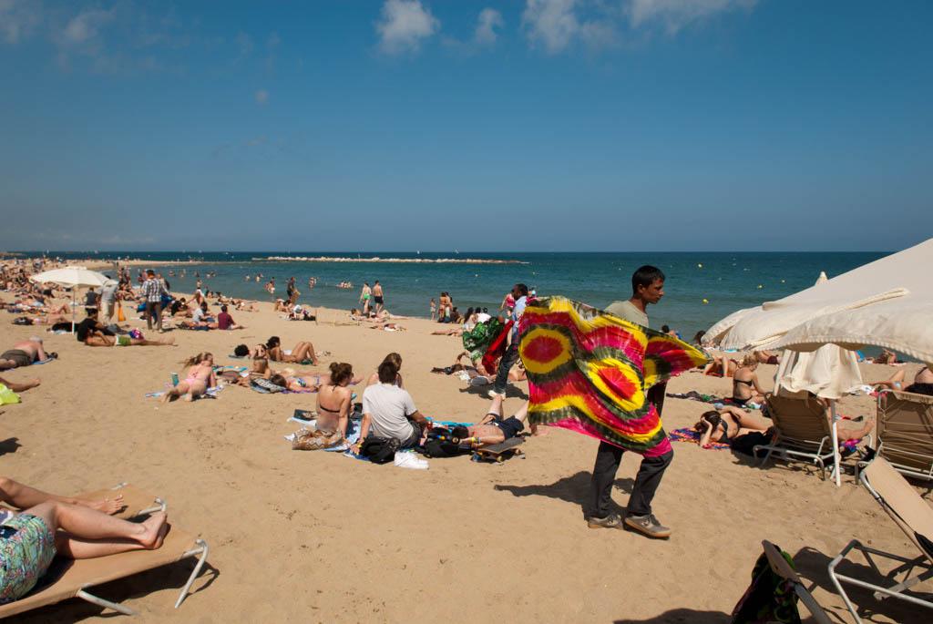 Beach of Barcelona, Spain. A seller of beach wraps