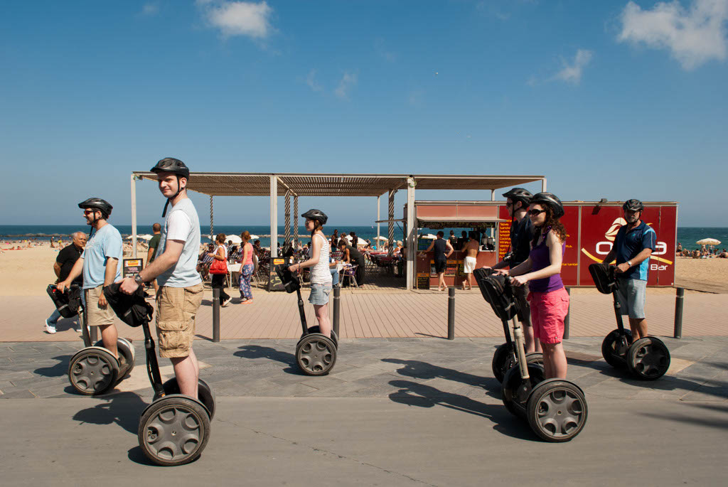 Beach of Barcelona, Spain. A group visiting the beach with the moto-bikes