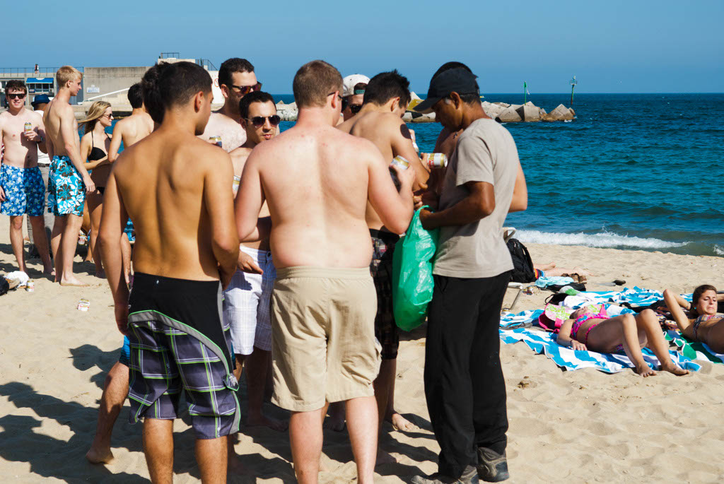 Beach of Barcelona, Spain. Clandestin seller of bear on the beach