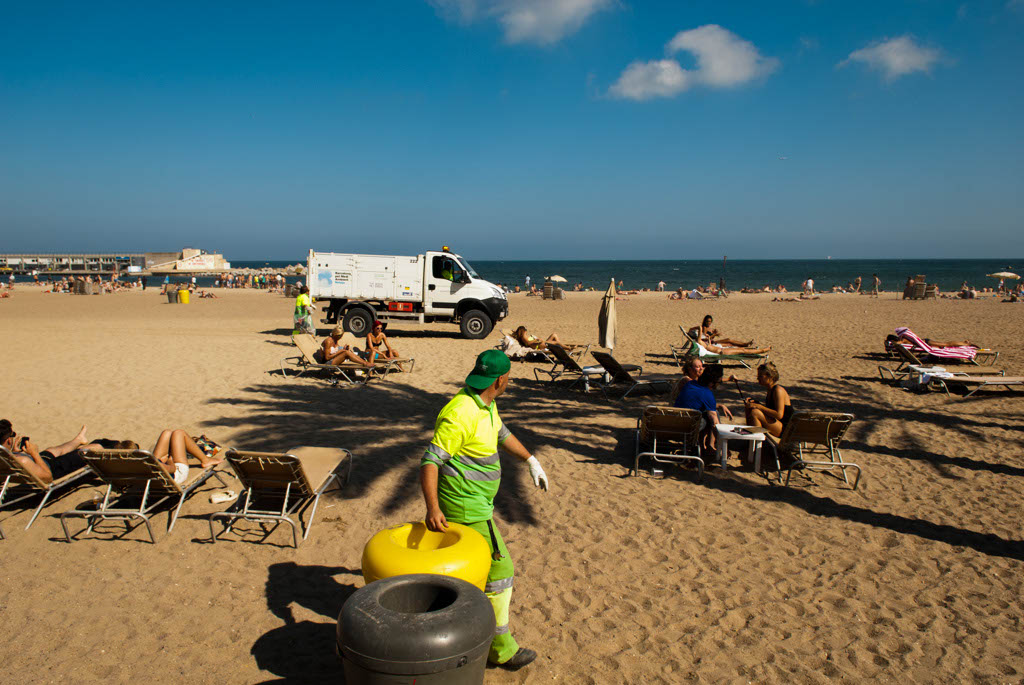 Beach of Barcelona, Spain. Cleaning the beach in the afternoon