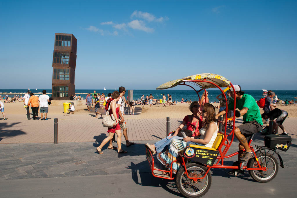 Beach of Barcelona, Spain. A rickshaw  for tourists