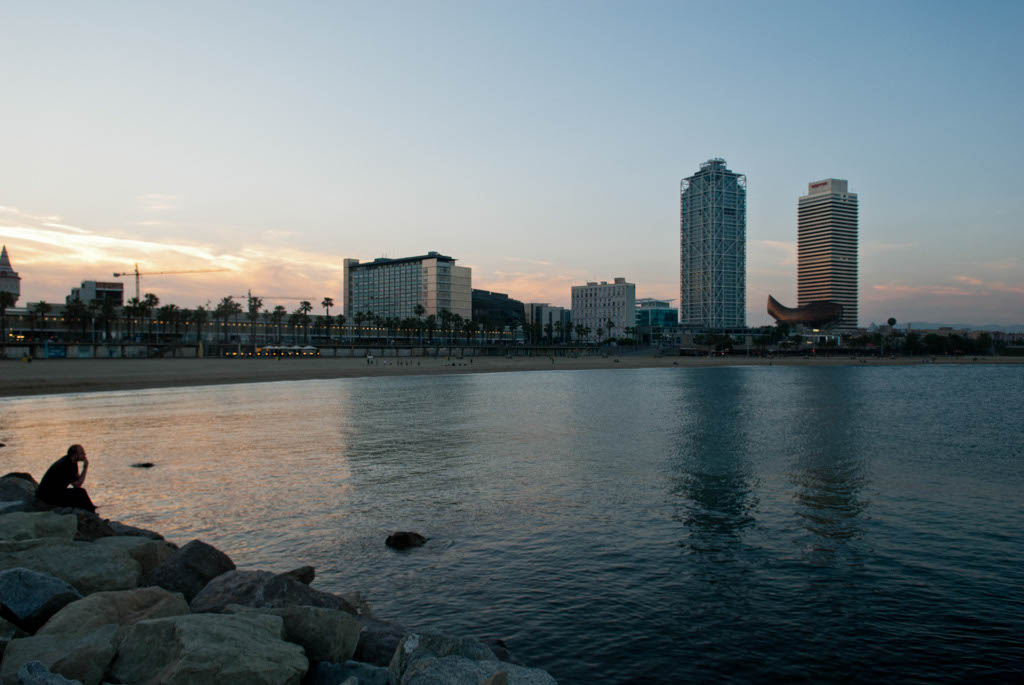 Beach of Barcelona, Spain. The Mafre Tower and the Hotel Arts and the sea in the evening