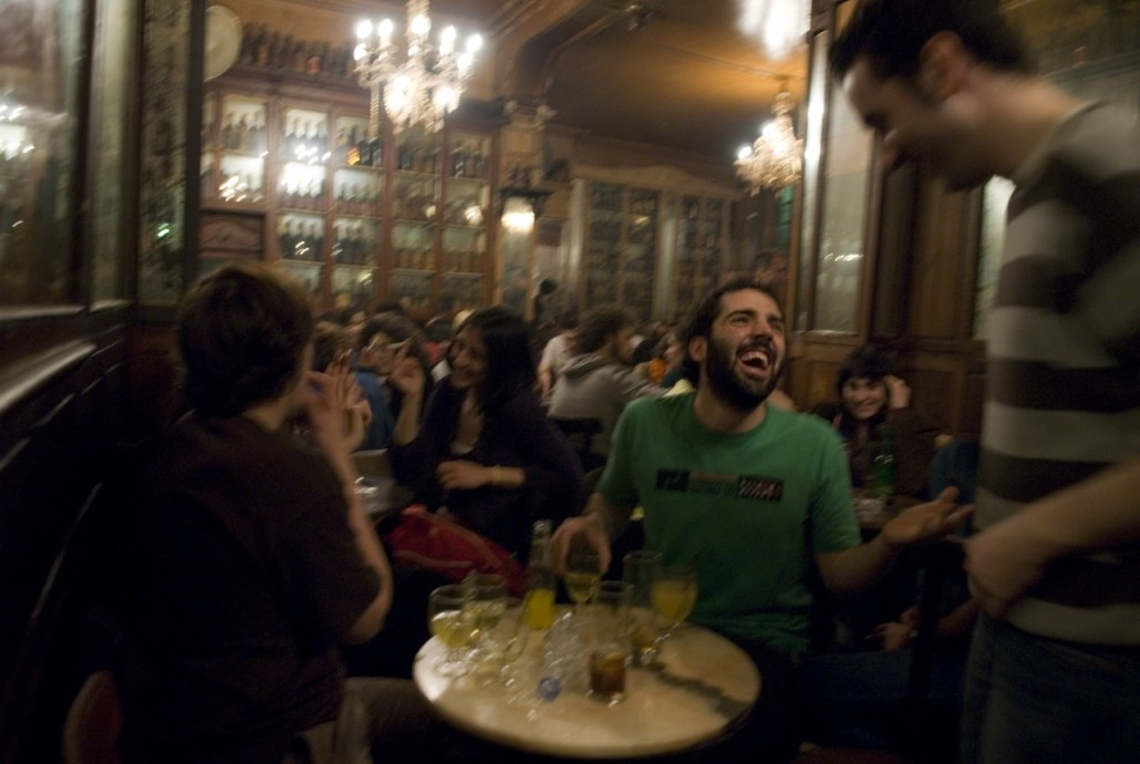 People have fun on Friday night at Bar Marsella, the temple of the absinthe drink in Barcelona