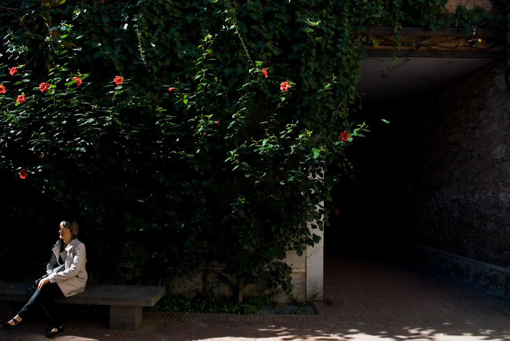 Spain, Barcelona. The Gardens and Public Courtyards: the dark passageway on la Torre de les Aigües, the first patio returned to the public.