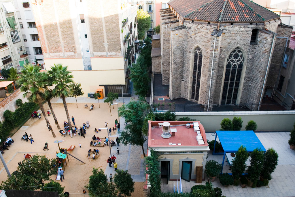 Spain, Barcelona. The Gardens and Public Courtyards: the courtyard at the end of the Pasaje Rector Oliveras below the rear faÁade of the 13th century Church of The Conception.