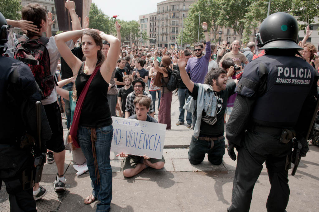 Barcelona, Spain. May 27, 2011. The police tried to remove the demonstrators from Plaça Catalunya, in Barcelona Spain. Thousands of people of the 15-M movement (Indignados) have been camping in the center of the city during the last two weeks, to protest against the financial crisis and the government's cuts for welfare . Finally the demonstrators managed to stay.