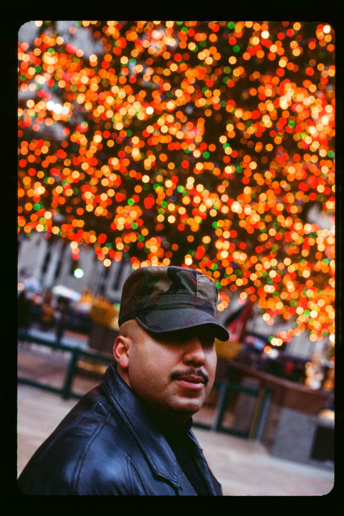 man and Christmas tree