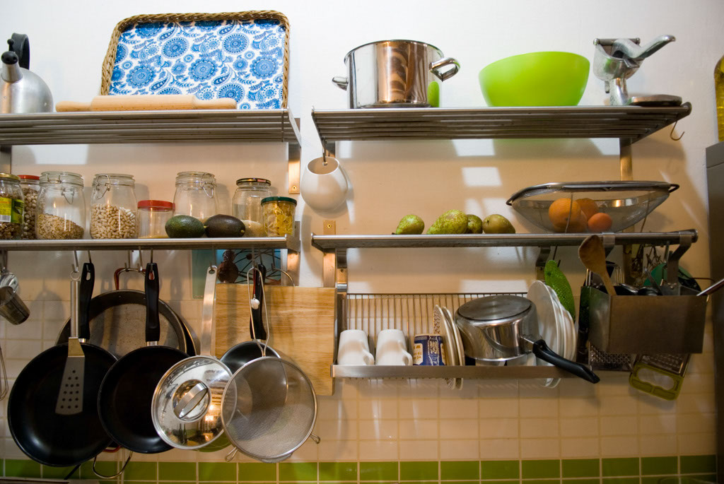 R3project kitchen. IKEA Stainless steal hanging system, fully recyclable and minimum use of materials. Locally sourced tiles by the company TAU