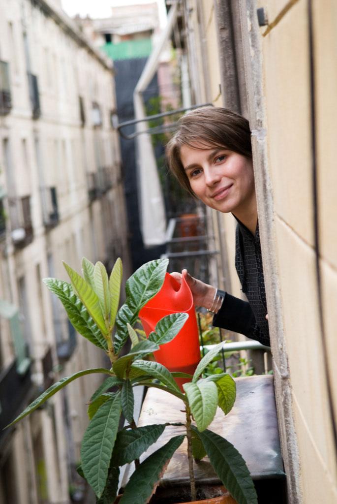 Petz Scholtus watering her plants