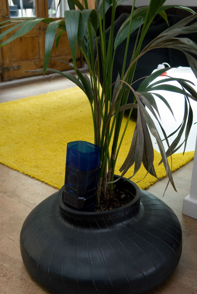 Plant pot made from a recycled inner car tire tube. Design by Curro Claret for Zicla. Also in the picture: rug by Nani Marquina, eco-friendly cork floor and Bidon Lamp
